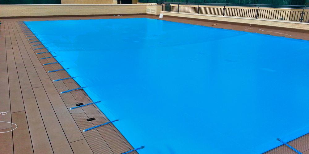 Lonas de piscina dexterior soluciones valladolid for Cobertor de piscina automatico